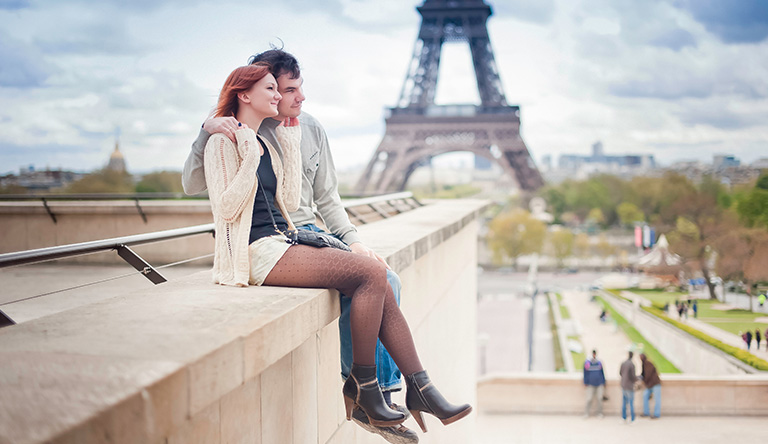 couple-sitting-on-the-wall-paris-france.jpg