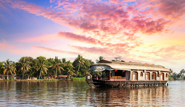 house-boat-in-backwaters-alleppey-kerala-india-at-evening