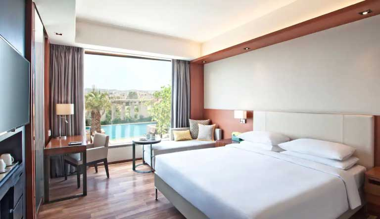 Hyatt-Regency-Amritsar-King-Bed-Pool-View.jpg