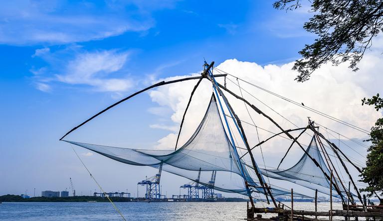chinese-fishing-nets-with-blue-cloudy-sky-in-kochi-kerala-india.jpg