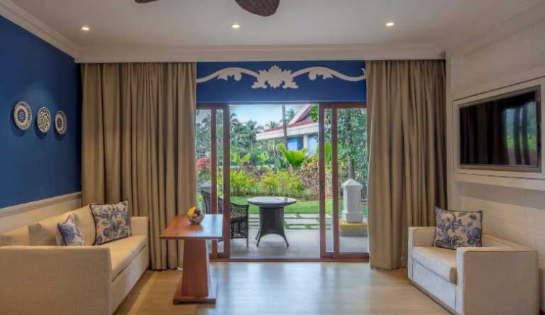 Taj-Exotica-Resort-and-Spa-Premium-Villa-Room-Garden-View-Living-Area.jpg