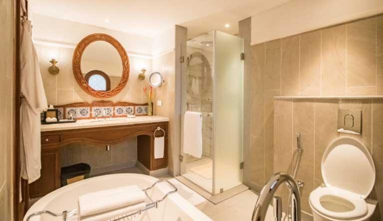 Taj-Exotica-Resort-and-Spa-Villa-Room-Garden-View-Bathroom.jpg