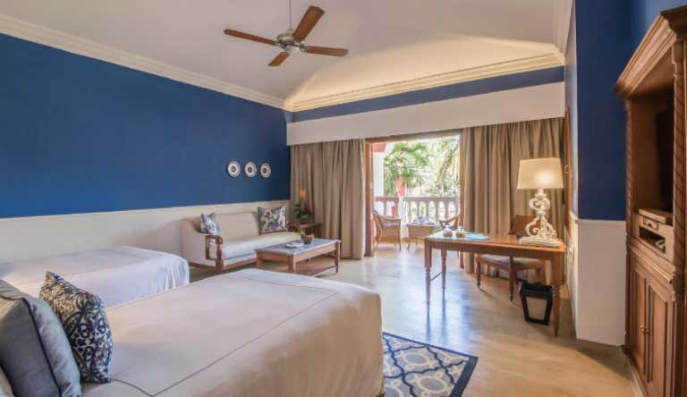 Taj-Exotica-Resort-and-Spa-Villa-Room-Garden-View-Bedroom.jpg