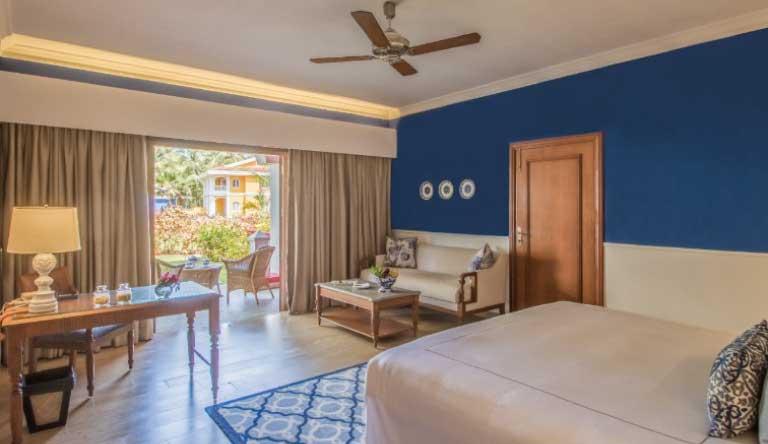 Taj-Exotica-Resort-and-Spa-Villa-Room-Garden-View-QueenBed-Room.jpg