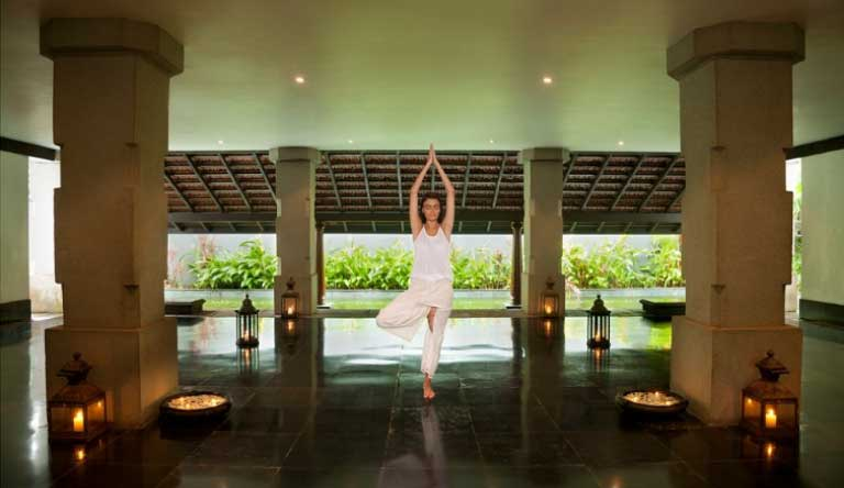 Taj-Exotica-Resort-and-Spa-Yoga-Ritual.jpg