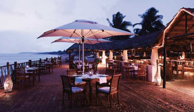 Taj-Holiday-Village-Resort-and-Spa-Restaurant-Evening-View.jpg