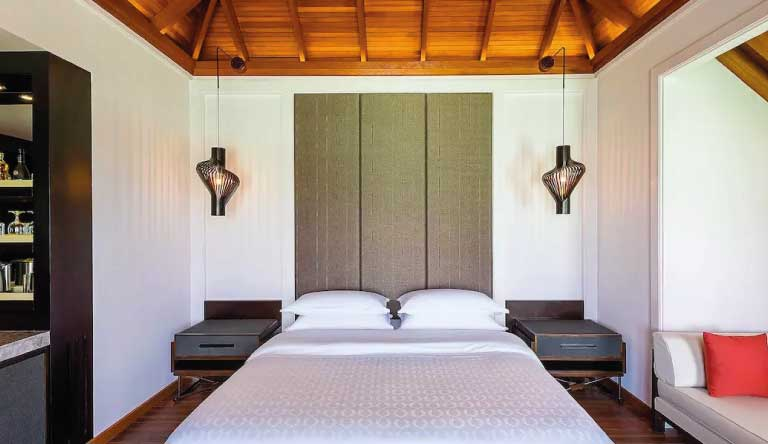 Sheraton-Maldives-Full-Moon-Resort-and-Spa-Water-Bungalow-Guest-Bedroom.jpg
