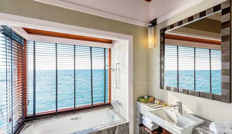 Sheraton-Maldives-Full-Moon-Resort-and-Spa-Water-Bungalow-Guest-Room-Bathroom.jpg