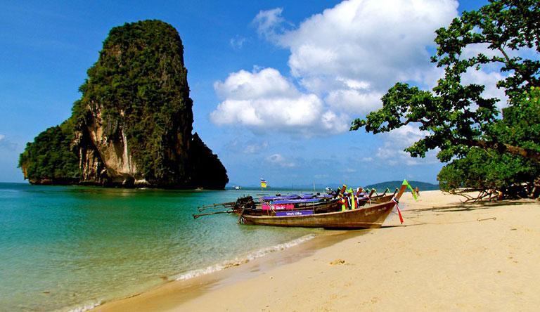 boat-docked-near-beach-phuket-thailand