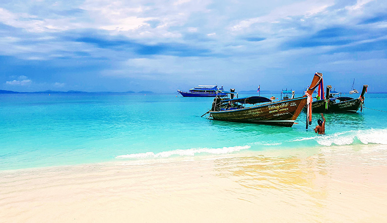 two-brown-boats-on-the-beach-phuket-thailand